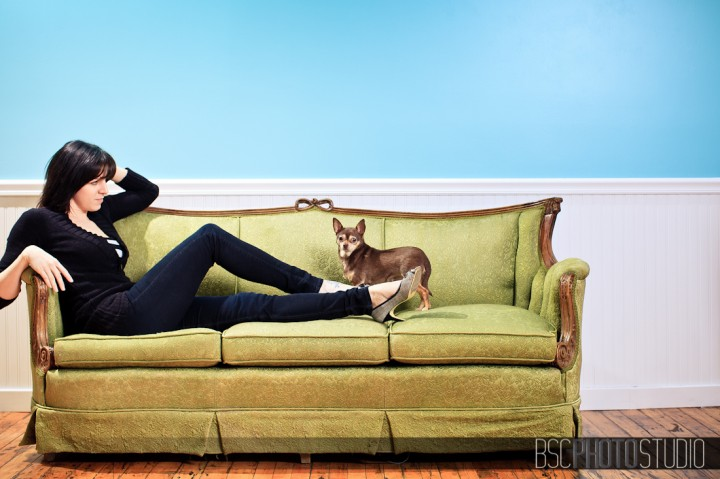 Professional portrait photography on antique couch with little chihuahua