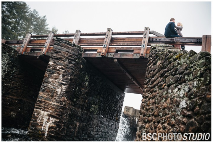Chatfield State Park bridge and waterfall engagement photography