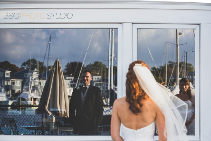 Modern CT documentary wedding photo at Milford Yacht Club bride and groom reflection